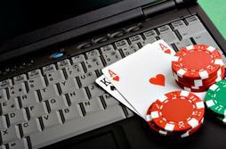 Online poker may soon be criminalized in Massachusetts.