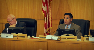Nevada Gaming Commission Chairman Peter Bernard -- left -- and Gov. Brian Sandoval -- right