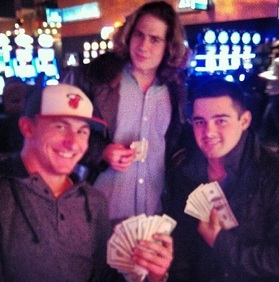 Manziel (bottom left) Shows Off Casino Winnings