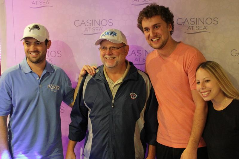 Joe Cada, Ryan Riess and Loni Harwood snap a photo with a player