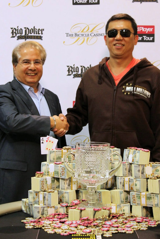 Bike Tournament Director Mo Fathipour congratulates 2014 CPPT main event winner Shan Jing