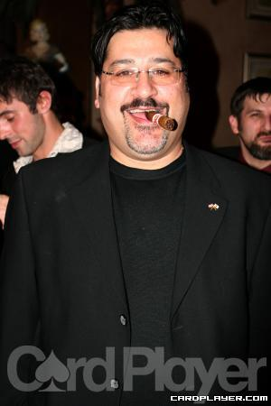 Amir Vahedi poses for a photo in 2006 with one of his trademark cigars.