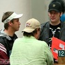 Three Shooting Stars: Phil Hellmuth and Gavin Smith talk with Layne Flack after busting out on Day 1b. Flack was one of five Shooting Stars to survive Day 1a.