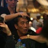 Chau Giang enjoys a massage on Day 1b of the WPT Bellagio Doyle Brunson Five Diamond World Poker Classic