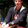 "Tom ""Durrr"" Dwan pulls in a pot on Day 1b of the 2007 Foxwoods World Poker Finals"